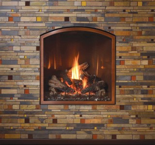 Stone wall with traditions arch fireplace