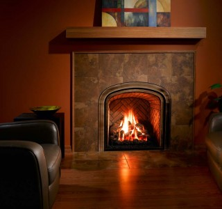 Cozy warm living space with burning fireplace