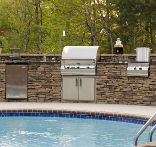 Pool-side outdoor kitchen and grill