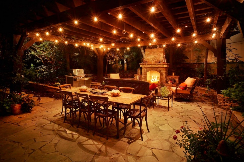 night photograph of outdoor kitchen and patio