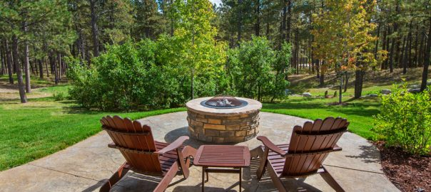 two deck chairs in front of outdoor firepit
