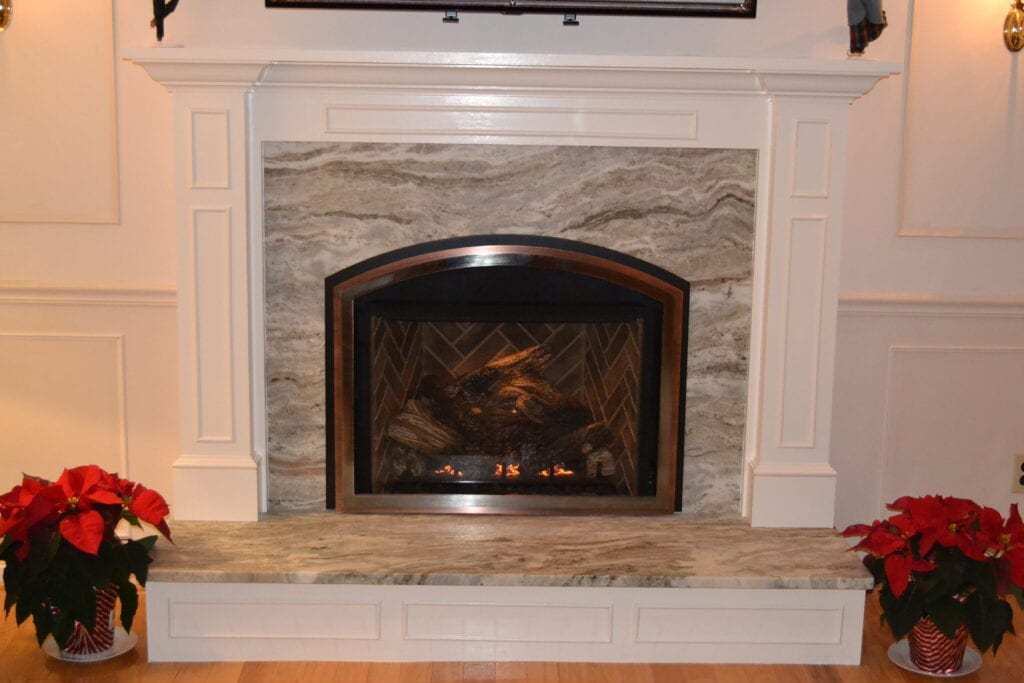 stone wall fireplace with white moulding