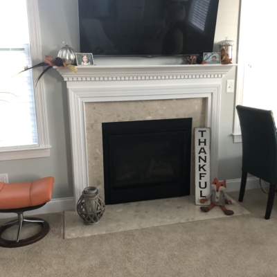 fireplace with tv over it