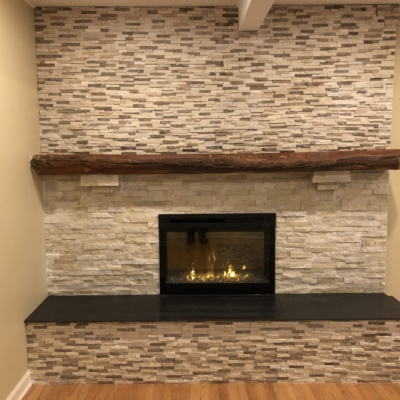 stone wall with new fireplace
