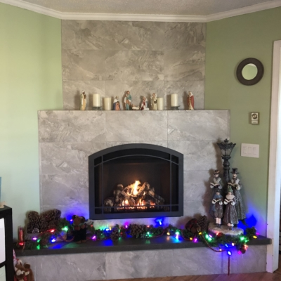 stone fireplace at Christmas