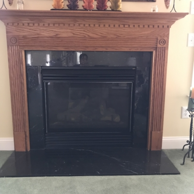 wood mantel and fireplace