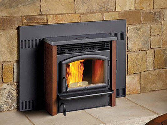 pellet stove against stone wall