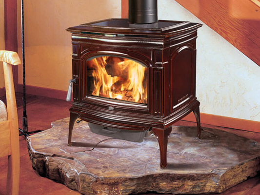 brown ceramic wood stove on live edge wooden mantle