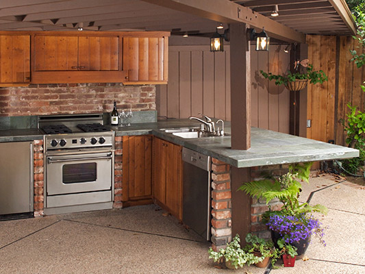 outdoor kitchen with wood cabinet accents